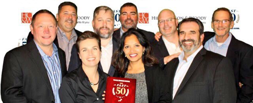 TrialCard leaders pose together to celebrate being named to the Triangle Business Journal's 2016 Fast 50 List