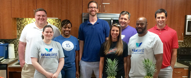 TrialCard employees pose together after volunteering at a local charitable organization