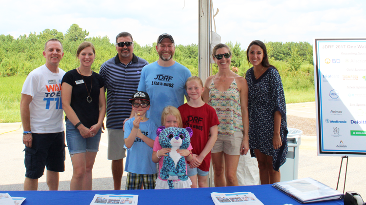 A family and other volunteers for the Juvenile Diabetes Research Foundation pose for a photo